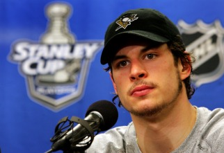 PITTSBURGH - MAY 13: Sidney Crosby #87 of the Pittsburgh Penguins is interviewed by the media after his team's 4-1 victory over the Philadelphia Flyers in game three of the Eastern Conference Finals of the 2008 NHL Stanley Cup Playoffs at Wachovia Center on May 13, 2008 in Philadelphia, Pennsylvania. The Penguins lead the series 3-0. (Photo by Jim McIsaac/Getty Images)